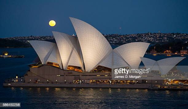 The Supermoon rises above the skyline with the Sydney Opera House in foreground providing a spectacular view for all those travelling home from the...