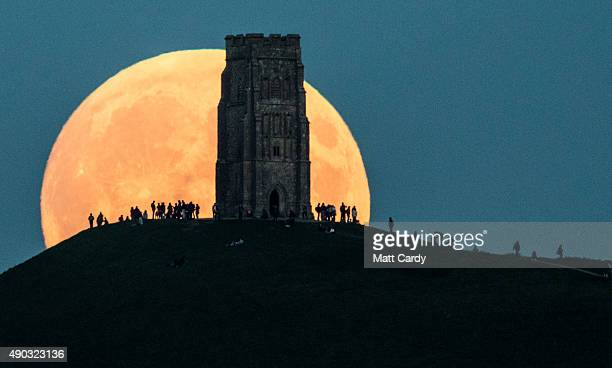 The supermoon rises behind Glastonbury Tor on September 27 2015 in Glastonbury England Tonight's supermoon so called because it is the closest full...
