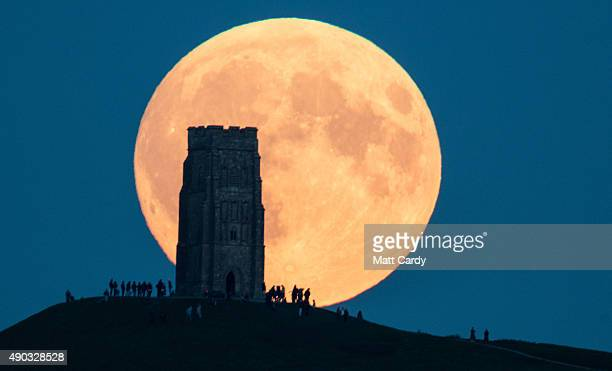 The supermoon rises behind Glastonbury Tor on September 28 2015 in Somerset England Tonight's supermoon so called because it is the closest full moon...