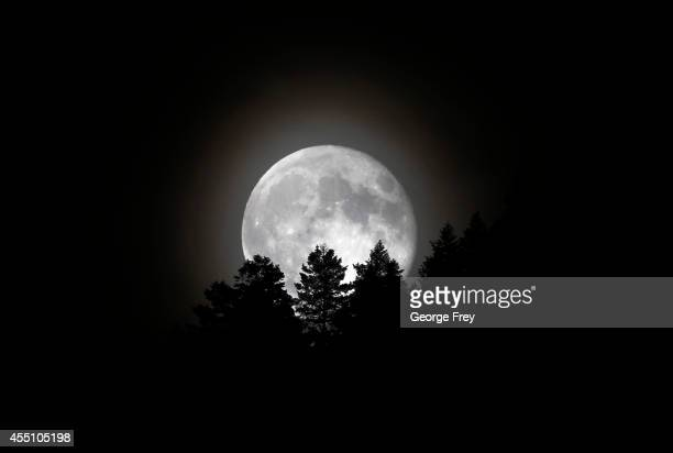 The Supermoon rises over a mountain ridge on September 9 2014 in Provo Utah Tonight's supermoon was the third in a trio of supermoons this summer To...
