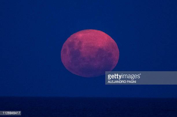 The Supermoon rises over the Rio de la Plata as seen from Buenos Aires on February 19 2019