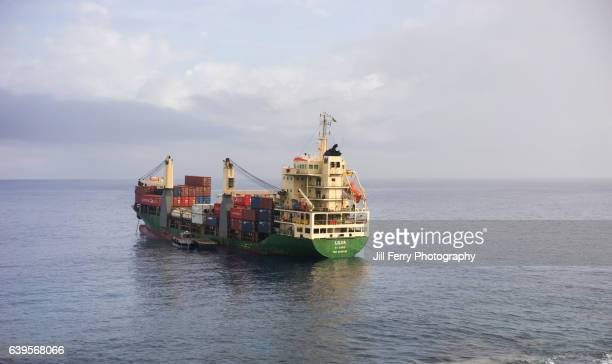 the supply ship - niue island stock photos and pictures