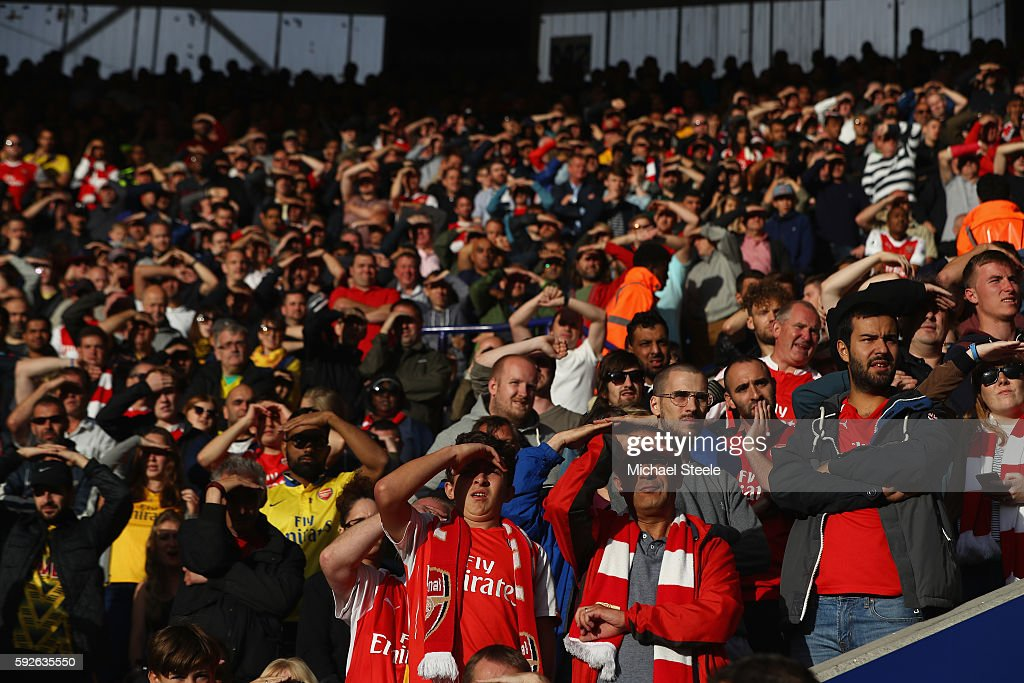 The supporters of Arsenal look on during the Premier League match between Leicester City and Arsenal at The King Power Stadium on August 20, 2016 in Leicester, England.