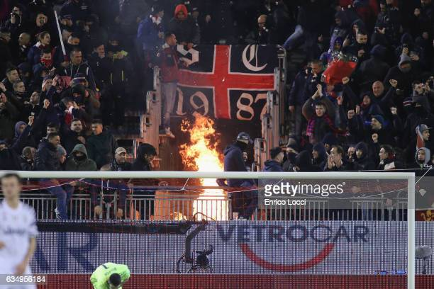 the supporters of Cagliari start a fire during the Serie A match between Cagliari Calcio and Juventus FC at Stadio Sant'Elia on February 12 2017 in...