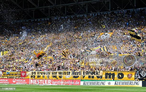 The supporters of Dresden celebrate before the Third League match between Dynamo Dresden and Wacker Burghausen at the Gluecksgas Stadium on May 7...