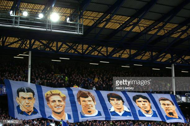 The supporters of Everton FC display a banner showing former players Dixie Dean Dave Hickson Joe Royle Bob Latchford Graeme Sharp and Duncan Ferguson...