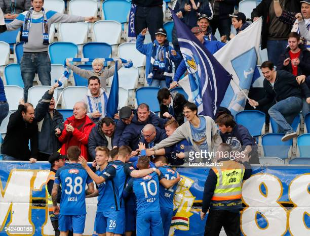 The supporters of MTK Budapest celebrate the first goal with the players during the Hungarian Cup Quarter Final 2nd Leg match between MTK Budapest...