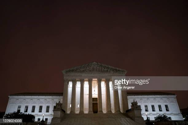 The Supreme Court is illuminated early Monday morning before the start of the Senate Judiciary Committee confirmation hearing for Supreme Court...