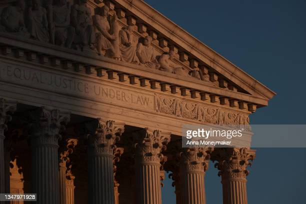 The Supreme Court is seen at sunset on Capitol Hill on October 21, 2021 in Washington, DC. Texas officials asked the Supreme Court on Thursday to not...
