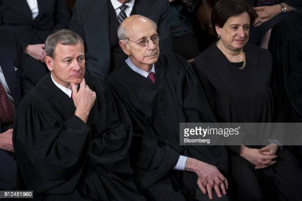 The Supreme Court Justices, from bottom left, Chief Justice John Roberts, Stephen Breyer, and Elena Kagan listen during a State of the Union address...