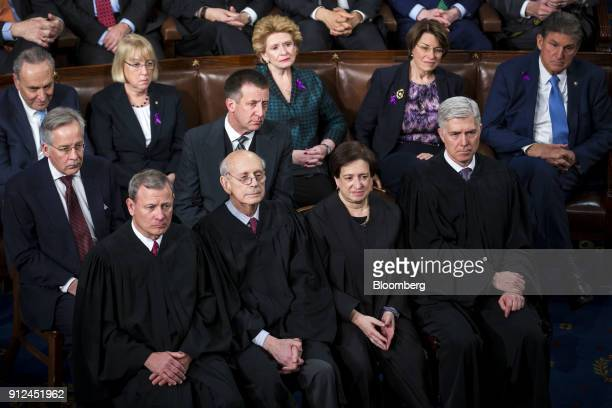 The Supreme Court Justices from bottom left Chief Justice John Roberts Stephen Breyer Elena Kagan and Neil Gorsuch listen during a State of the Union...