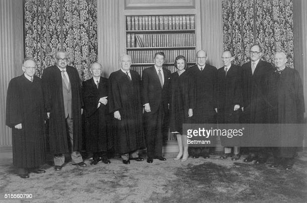 The Supreme Court Justices pose with the President in the Supreme Court conference room From left are Justices Harry Blackmun Thurgood Marshall...