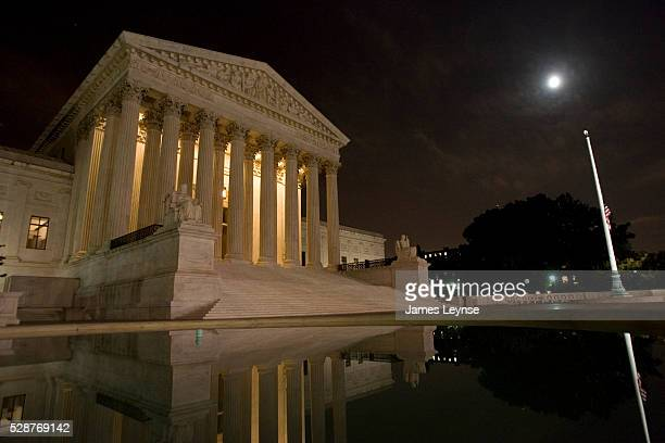 The Supreme Court of the United States at night.