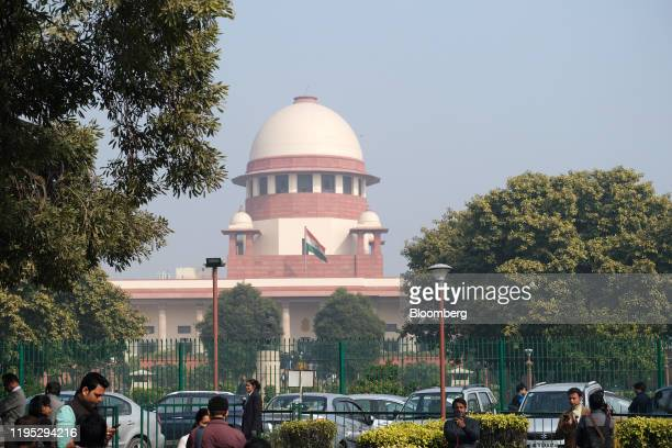 The Supreme Court stands in New Delhi India on Wednesday Jan 22 2020 India's top court has deferred a hearing on cases challenging the constitutional...