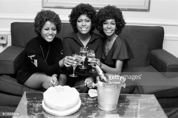 The Supremes left to right Cindy Birdsong Jean Terrell and Mary Wilson toasting a happy birthday to their lead singer Jean who is celebrating her...