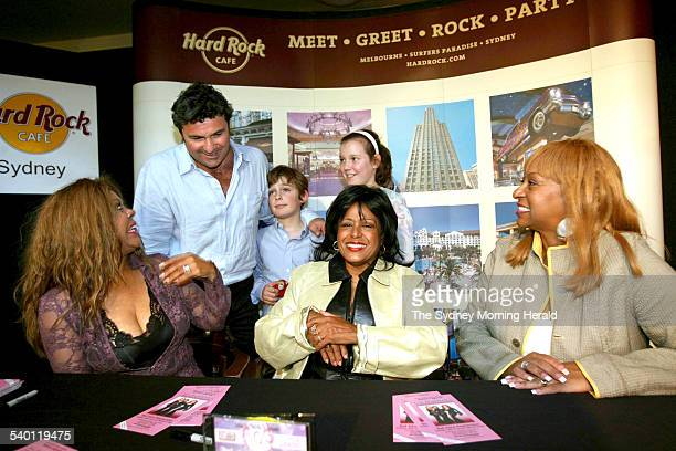 The Supremes Two of the originals Scherrie Payne middle Lynda Laurence right and Freddi Poole at the Hard Rock Cafe with fan Benny Elias and his...