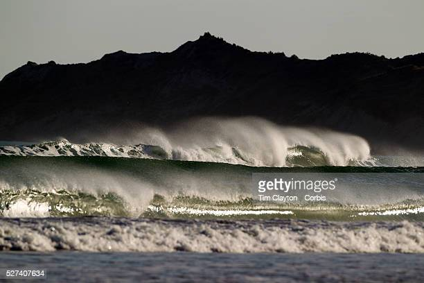 The surf rolls in at Wainui Beach near Gisborne Wainui beach is world famous as a surfing beach it's fantastic breaks and it's beautiful stretch of...