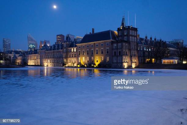 The surface of Hofvijver or 'Court Pond' is frozen in front of Mauritshuis museum and Binnenhof on February 28 2018 in The Hague Netherlands