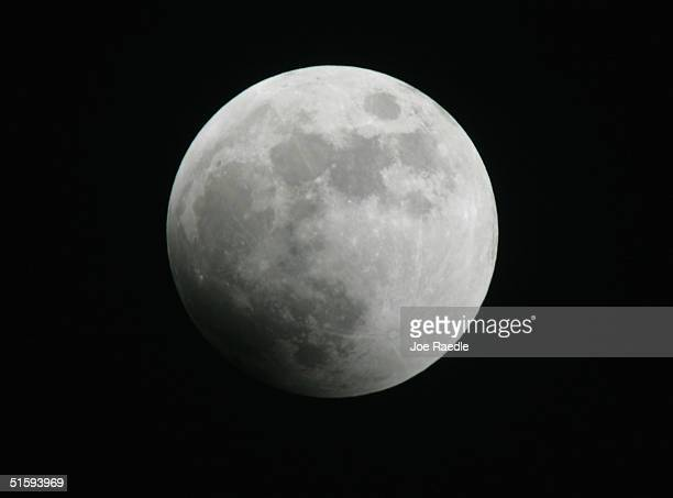 The surface of the moon is seen as it starts toward a total eclipse caused by the earth's shadow October 27 2004 in Miami Florida This is the last...