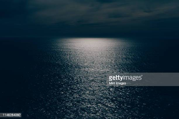 the surface of the seam textured, reflections of moonlight at night. - dark sky stock pictures, royalty-free photos & images