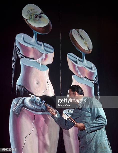 The surrealist painter Salvador Dali works on the figure of two birds in a large oil composition, Greenwich Village, New York.