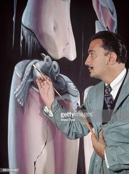 The surrealist painter Salvador Dali works on the figure of two birds in a large oil composition Greenwich Village New York