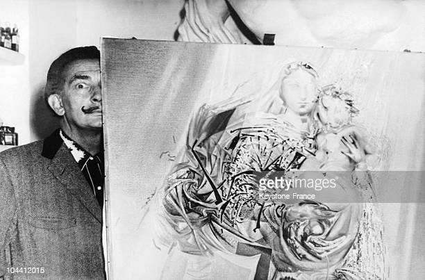 The surrealist Spanish painter Salvador DALI hiding behind his paint LA MADONA DE GUADALUPE in his home in Port Lligat Spain on November 5 1958