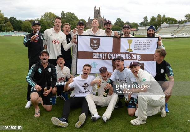 The Surrey team celebrate their championship after the Specsavers County Championship Division One match between Worcestershire and Surrey at County...