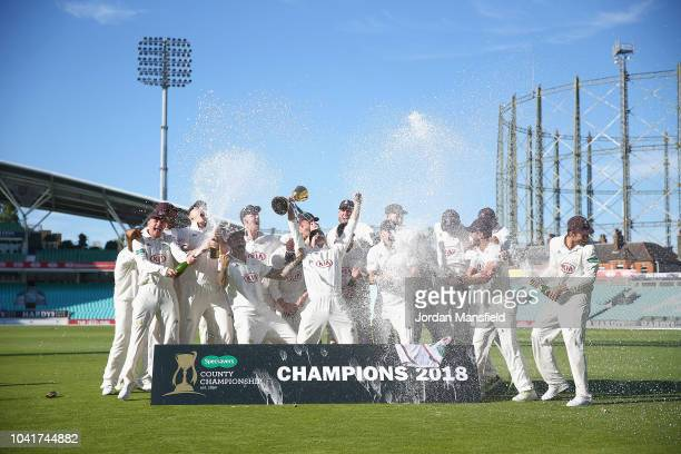 The Surrey team celebrate winning the Specsavers County Championship Division One Cup during Day Four of the Specsavers County Championship Division...