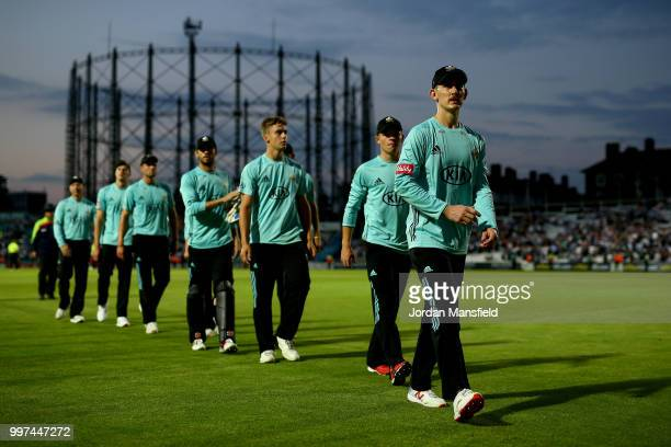 The Surrey team leave the field after victory in the Vitality Blast match between Surrey and Essex Eagles at The Kia Oval on July 12 2018 in London...