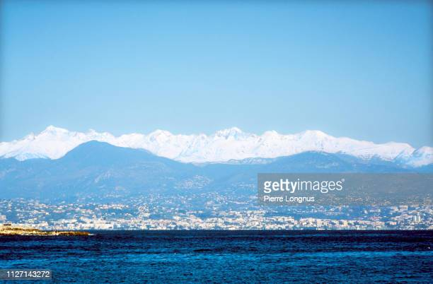 the surroundings of nice : cagnes sur mer, villeneuve loubet, nice hinterland and the snowy alps in backdrop - アルプマリティーム ストックフォトと画像