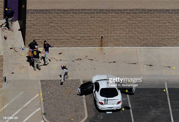 The suspects car was found in the back of the theatre ATF agents and police investigate the scene A shooting at The Century has left 12 people dead...