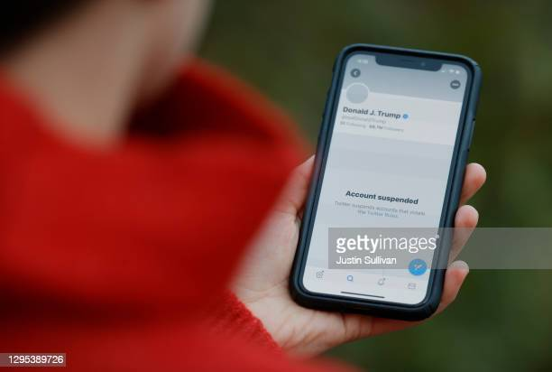 The suspended Twitter account of U.S. President Donald Trump appears on an iPhone screen on January 08, 2021 in San Anselmo, California. Citing the...