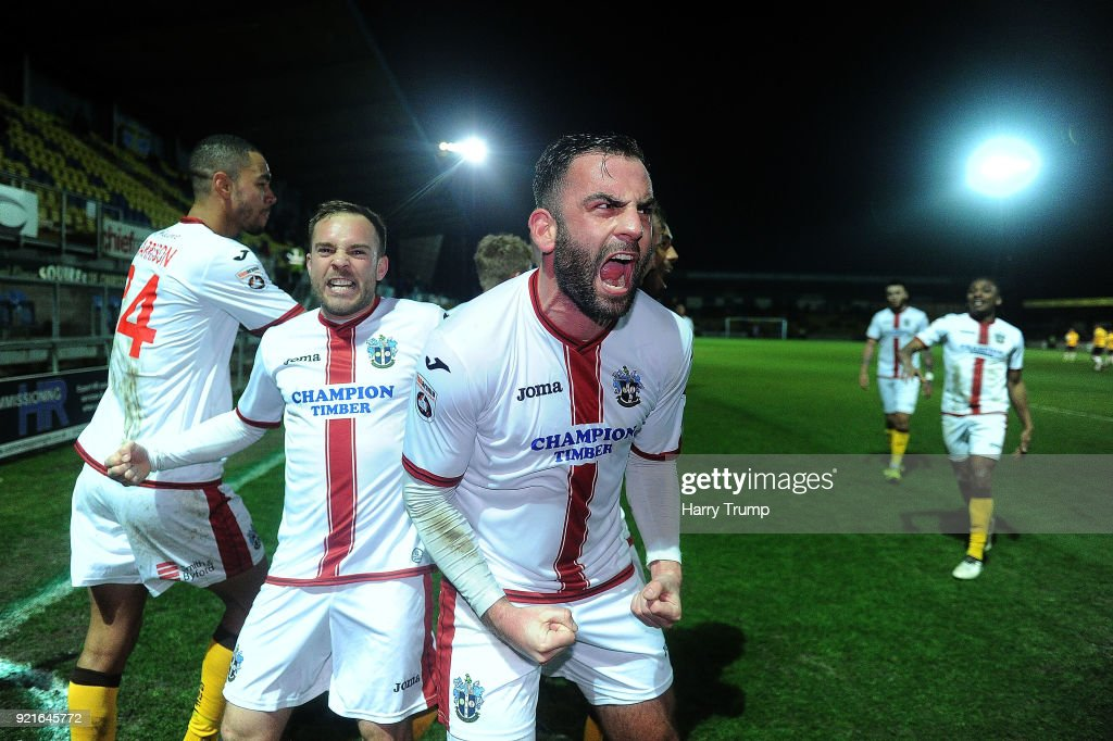 The Sutton players celebrate their last minute winning goal during the Vanarama National League match between Torquay United and Sutton United at Plainmoor on February 20, 2018 in Torquay, England.