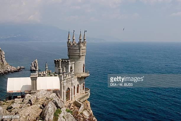 The Swallow's Nest castle in Lastochkino Gnezdo overlooking the Aurora Cliff 19111912 designed by Leonid Sherwood AyTodor cape on the Black Sea...