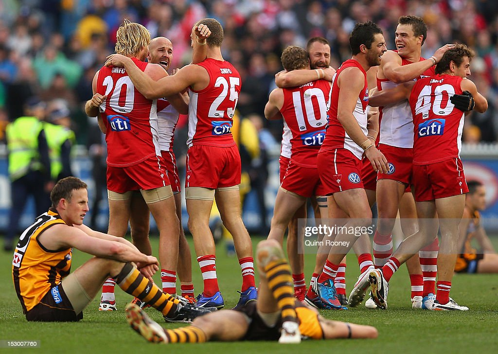 The Swans celebrate winning the 2012 AFL Grand Final match between the Sydney Swans and the Hawthorn Hawks at the Melbourne Cricket Ground on September 29, 2012 in Melbourne, Australia.
