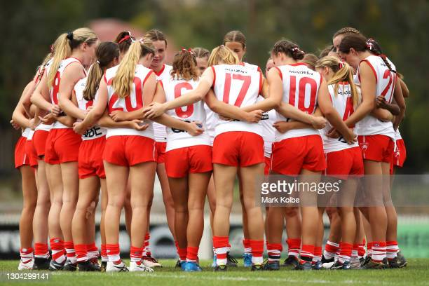 The Swans forms a huddle before play during the NAB AFLW U17 All Stars match between the GWS Giants and the Sydney Swans at Alan Ray Oval on February...