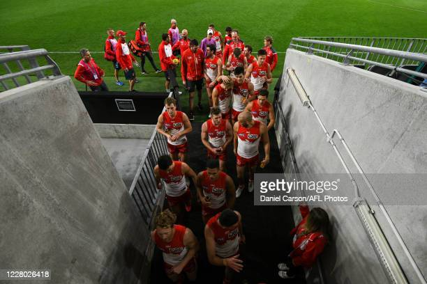 The Swans head into the rooms after the win during the 2020 AFL Round 12 match between the Sydney Swans and the GWS Giants at Optus Stadium on August...