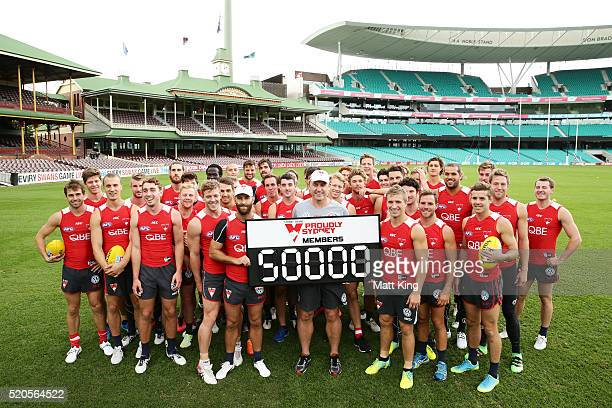 The Swans pose for a photograph to commemorate gaining 50000 members during a Sydney Swans AFL training session at Sydney Cricket Ground on April 12...