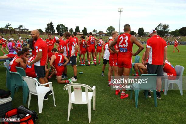 The Swans sit on the field during the halftime break of the AFL Inter Club match between the Sydney Swans and the Greater Western Sydney Giants at...