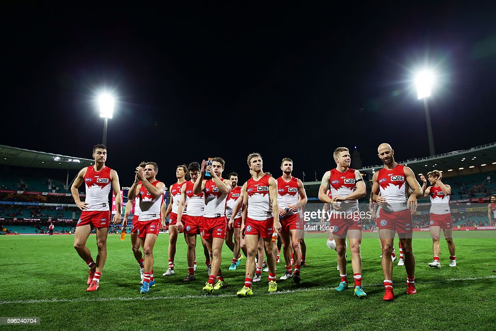 The Swans walk from the field after victory in the round 23 AFL match between the Sydney Swans and the Richmond Tigers at Sydney Cricket Ground on August 27, 2016 in Sydney, Australia.