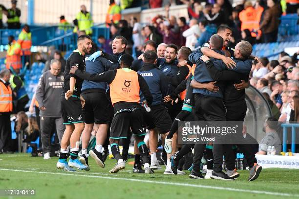 The Swansea City coaching staff celebrate during the Sky Bet Championship match between Leeds United and Swansea City at Elland Road on August 31...