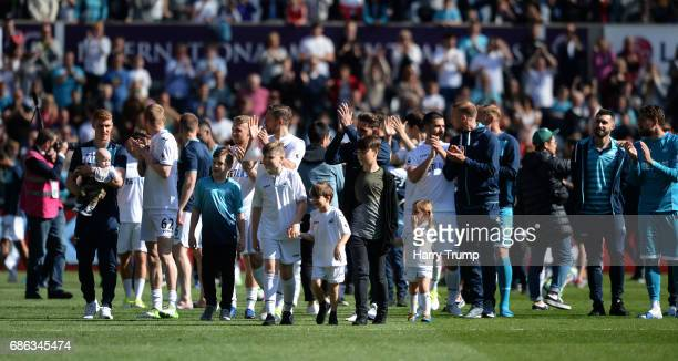 The Swansea City side salute the crowd at the final whistle during the Premier League match between Swansea City and West Bromwich Albion at the...