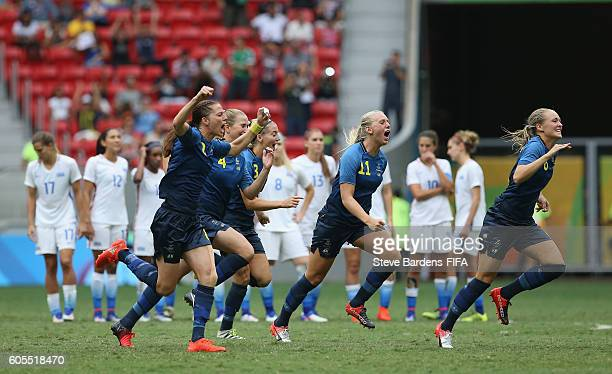 The Sweden players celebrate victory over the United States in a penalty shoot out during the Women's Quarter Final match between United States and...