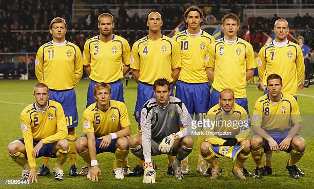 The Sweden team back row lr Marcus Allback Olof Mellberg Daniel Majstorovic Zlatan Ibrahimovic Kim Kallstrom Christian Wilhelmsson front row lr...