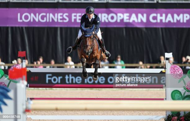 The Swedisch Show Jumper Peder Fredricson on horse HM All In wins the gold medal in the single show jumping competition of the FEIEuropean...