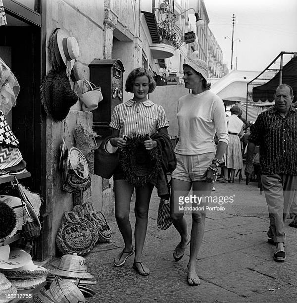 The Swedish actress Ingrid Bergman walking with her daughter Pia Lindstrom. Capri, the 50s.