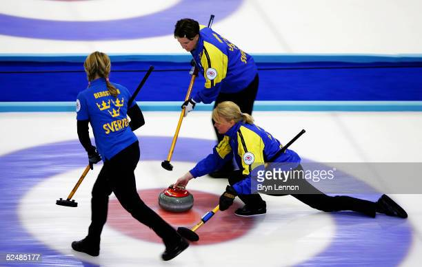 The Swedish curling team of Ulrika Bergman, Catherine Lindahl and Eva Lund in action during the World Women's Curling Championship final between USA...