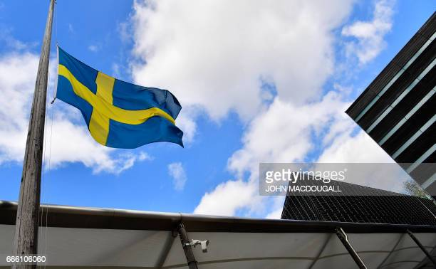 The Swedish flag is hoisted at halfmast on April 8 2017 at the Swedish embassy in Berlin the day after a stolen truck ploughed into a crowd in...