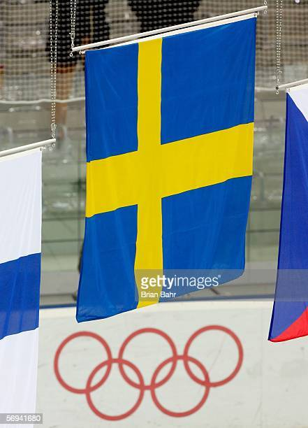 The Swedish flag is raised after Sweden defeated Finland 3-2 to win the gold medal during the final of the men's ice hockey match between Finland and...